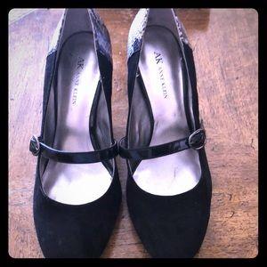 Black suede snakeskin trimmed shoes